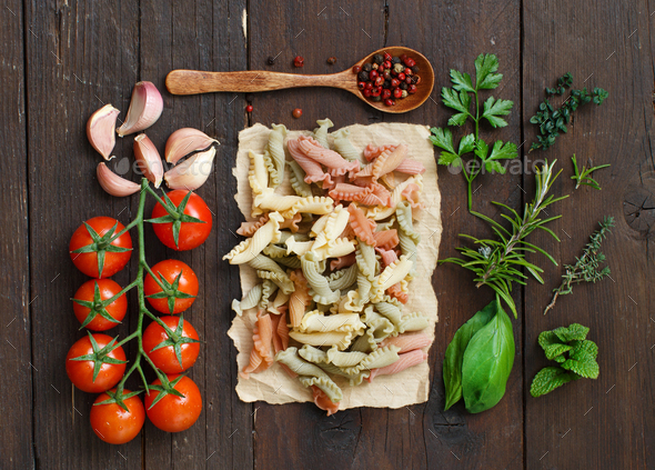 Tricolor pasta, vegetables and herbs - Stock Photo - Images