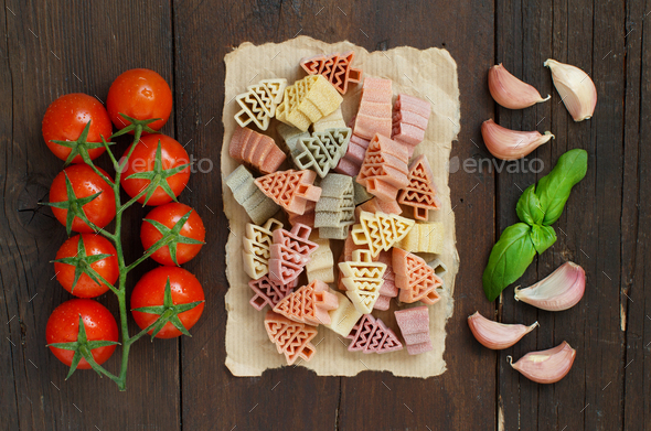 Tricolor fir tree shaped pasta, vegetables and herbs - Stock Photo - Images