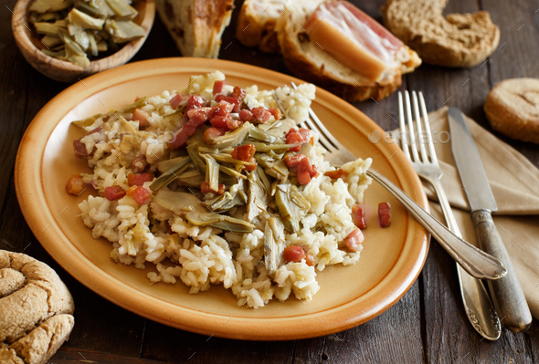 Risotto with artichokes and bacon - Stock Photo - Images