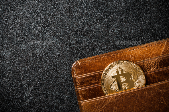 Bitcoin coin in wallet on black background - Stock Photo - Images