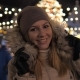Woman in Warm Clothing Smiling and Standing at Christmas Market with Illuminations - VideoHive Item for Sale