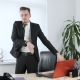 Happy Young Man in a Suit Dances in the Office. - VideoHive Item for Sale