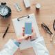 Doctor using smartphone app in hospital office - PhotoDune Item for Sale
