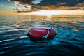 Red buoy for freediving floating in the ocean. - PhotoDune Item for Sale