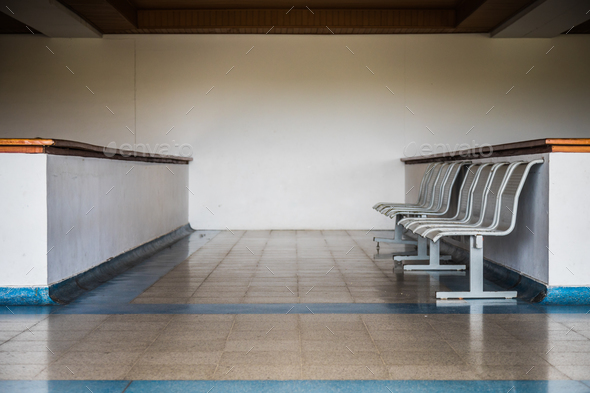 Small row of chairs in waiting room in Caribbean airport. - Stock Photo - Images