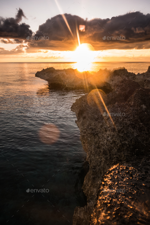 Big volcanic rocks in sunset lights in San-Andres island, Caribb - Stock Photo - Images