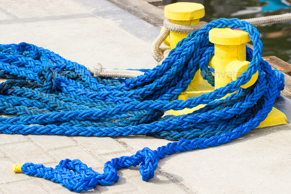 Blue rope and mooring bollard, detail of seaport, yachting concept - Stock Photo - Images