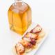 Marinated octopus sliced on potatoes isolated on white - PhotoDune Item for Sale