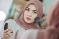 muslim woman applying makeup - PhotoDune Item for Sale