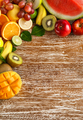 fresh mixed fruits on rustic wooden background - PhotoDune Item for Sale