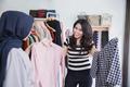 woman choosing a new shirt - PhotoDune Item for Sale