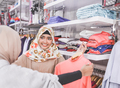 female muslim best friend at fashion store - PhotoDune Item for Sale