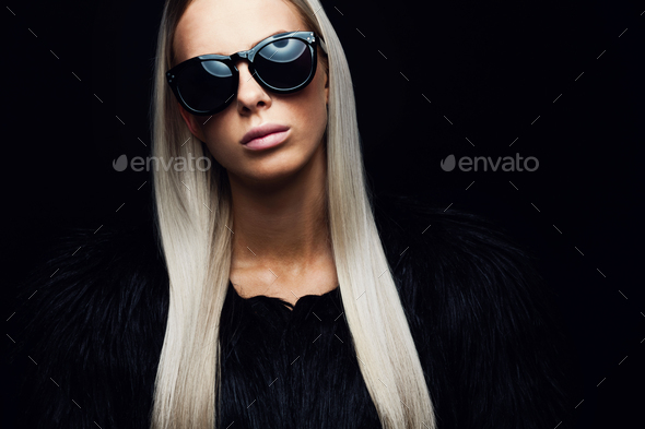 Fashion woman with hairy jacket and sunglasses - Stock Photo - Images