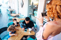 family in a cafe, mom takes a photo - PhotoDune Item for Sale