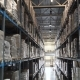 Camera Moves Up on Shelves of Cardboard Boxes Inside a Storage Warehouse - VideoHive Item for Sale