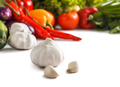 fresh raw garlic with some vegetables at the background - PhotoDune Item for Sale