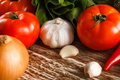 garlic, tomato, and onion on rustic wooden table - PhotoDune Item for Sale