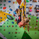 Young woman bouldering on overhanging wall in  climbing gym - PhotoDune Item for Sale