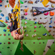 Young woman bouldering in climbing gym - PhotoDune Item for Sale