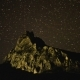 the Motion of Stars in the Night Sky Above the Rock - VideoHive Item for Sale