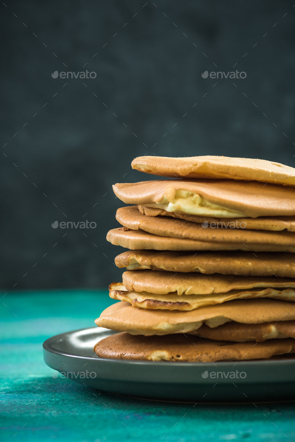 Pile of homemade pancakes on plate. Copy space. - Stock Photo - Images