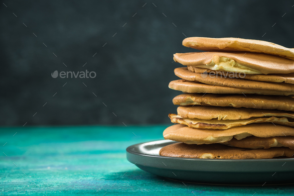 Homemade pancakes stack in pile on plate, copy space - Stock Photo - Images