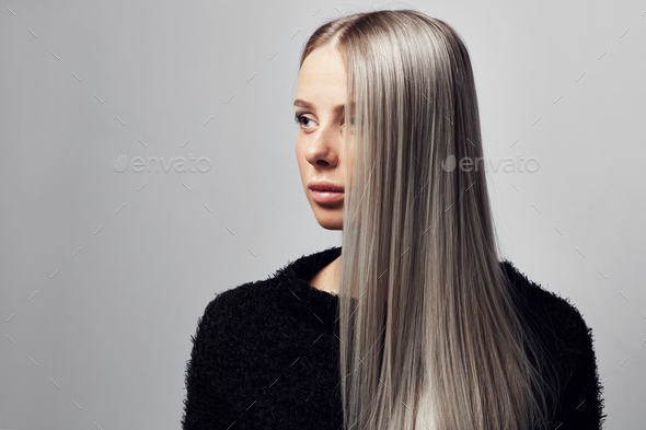 Portrait of a beautiful blonde woman with hairy jacket - Stock Photo - Images