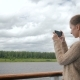 Woman Taking Photo of Landscape with Smartphone on Deck of Cruise Ship - VideoHive Item for Sale