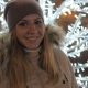 Young Woman in Warm Clothing Smiling Standing amid Christmas Illuminations - VideoHive Item for Sale