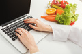 Female nutritionist working on laptop - PhotoDune Item for Sale