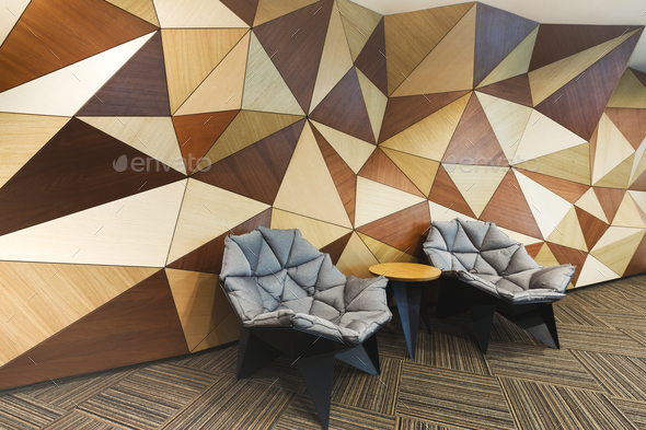 Modern hotel lobby with abstract wooden wall - Stock Photo - Images