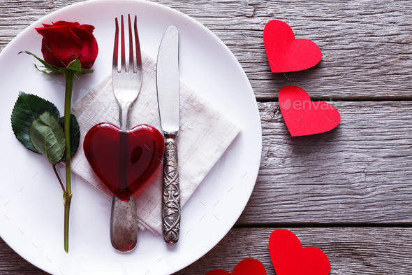 Valentine day background red glass heart on the plate - Stock Photo - Images