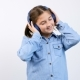 Little Girl with Headphones on Listening To Music - VideoHive Item for Sale