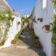 Narrow street in Alberobello town - PhotoDune Item for Sale