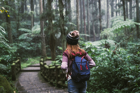Young woman traveler walking in the forest - Stock Photo - Images