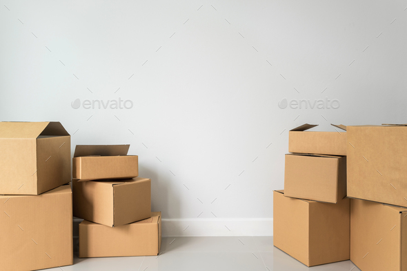 Stack of cardboard boxes in empty room - Stock Photo - Images
