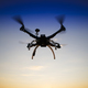 Quadrocopter in flight at sunset - PhotoDune Item for Sale