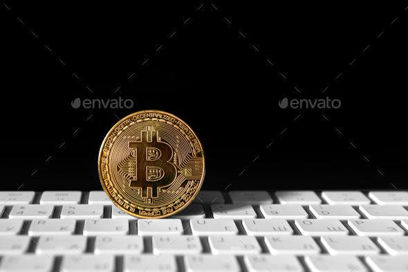Bitcoin gold coin on keybord - Stock Photo - Images