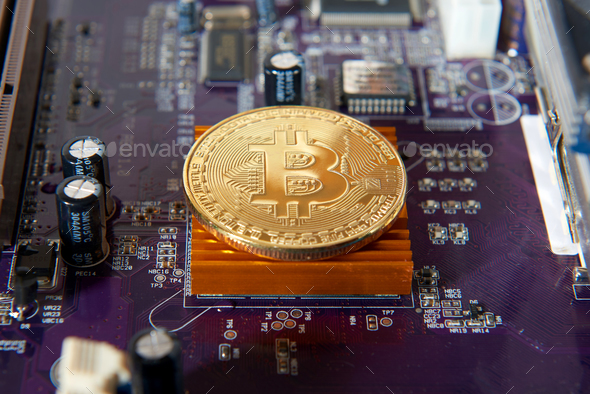 Gold Bitcoin electronic computer processor board - Stock Photo - Images
