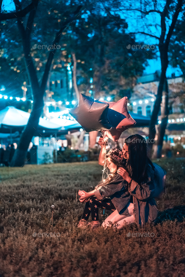 Family is spending time in the evening park - Stock Photo - Images