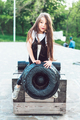 preschool girl sitting on top of a cannon - PhotoDune Item for Sale