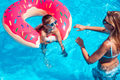 Little girl with her mom in swimming pool. - PhotoDune Item for Sale
