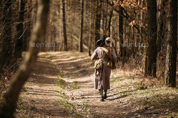 Young unidentified re-enactor dressed as Soviet soldier machine - Stock Photo - Images