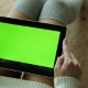 Sexy Woman Holding a Tablet with a Green Display - VideoHive Item for Sale