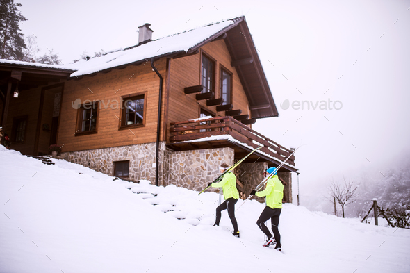 Senior couple going cross-country skiing. - Stock Photo - Images