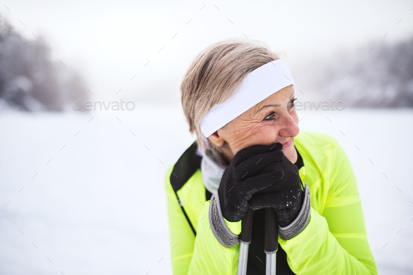 Senior woman skiing. - Stock Photo - Images