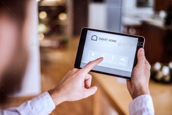 A tablet with smart home screen. - Stock Photo - Images