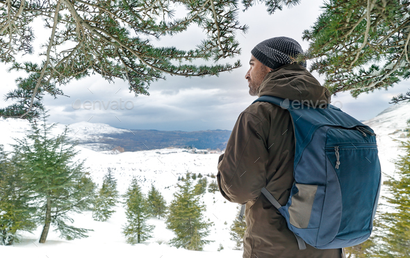 Traveler man in the snowy mountains - Stock Photo - Images
