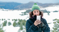 Happy woman using phone in the mountains - PhotoDune Item for Sale