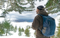 Traveler man in the snowy mountains - PhotoDune Item for Sale